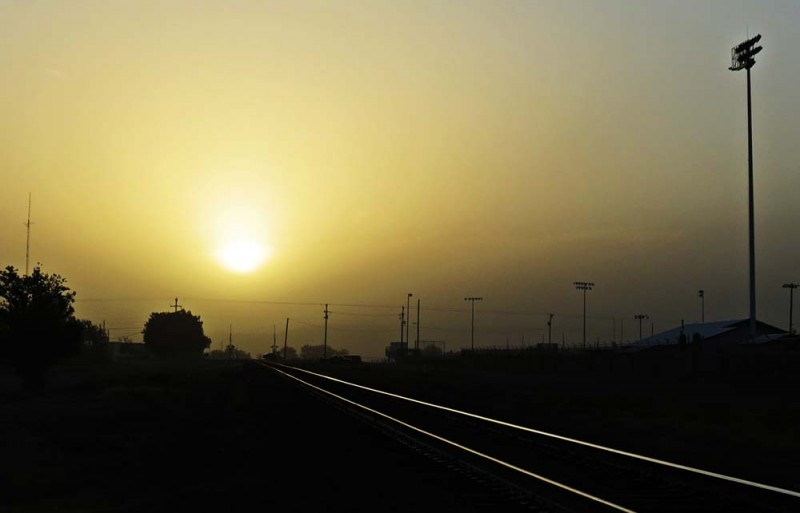 Cold Front at Dawn over the Tracks